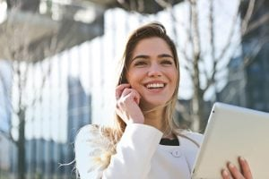 A woman smiling while talking on the phone