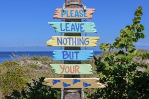 """A sign that reads: """"Please leave nothing but your footprints"""""""
