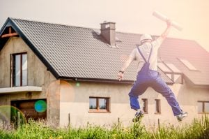 man in front of a home