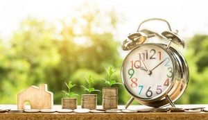 money and a clock as a sign for saving when moving abroad