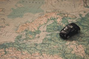 A figurine of a car on a map of Europe