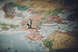 A figurine of a man on a map of Europe