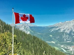 canada flag overlooking a landscape