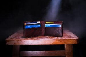 A wallet on a wooden surface.