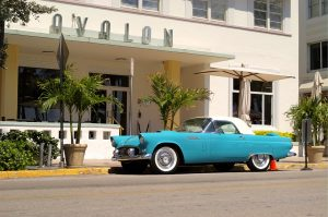 Car parked in front of a hotel on Ocean Drive