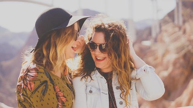 Two girls laughing.