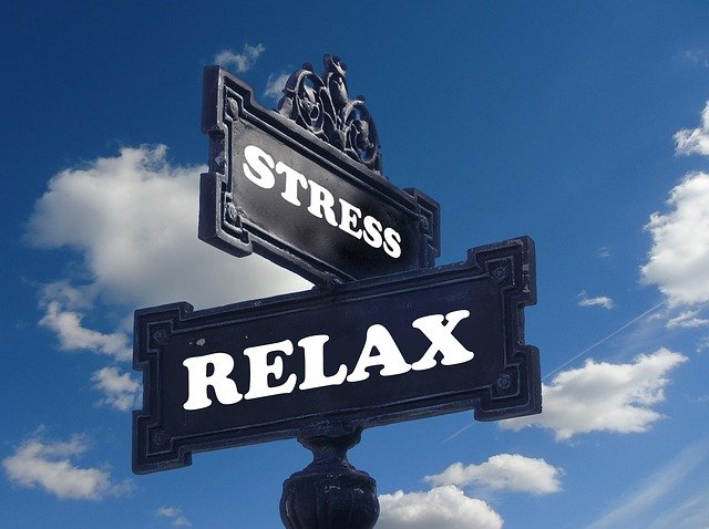 "A sign with written ""stress"" and ""relax"" on it,"