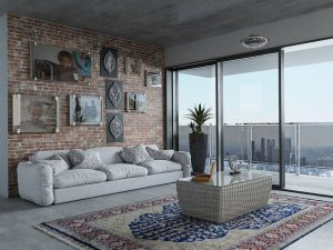 A living room in an apartment with a big window.