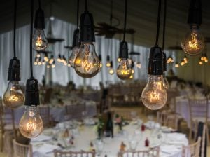 event setup Miami - light bulbs and tables