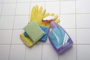 Cleaning supplies on tile