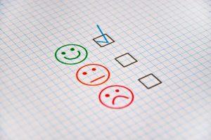 Three faces representing customer feedback.