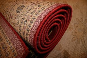 A red rolled up rug