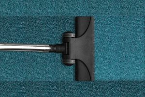 A vacuum cleaner on a carpet