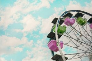 A green and pink Ferris whee.