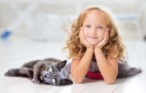 A girl and a black cat
