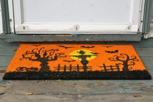 Black and orange welcome mat.