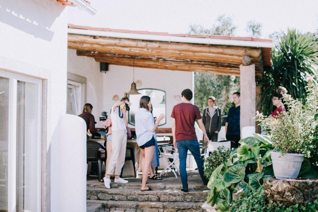 People standing in a backyard talking