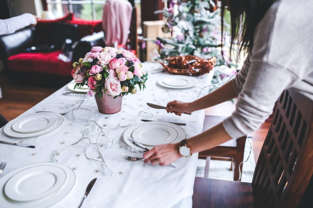 Woman setting a table for a dinner party