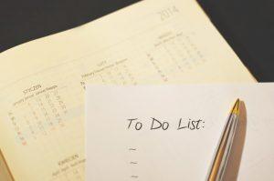 calendar and a pen on a to-do list