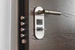 metal keyhole and a door handle on wooden door