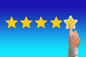 trustworthy movers for a hotel relocation -five star rating and a finger pointing to the fifth star