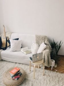 a rug, a coffee table and a couch