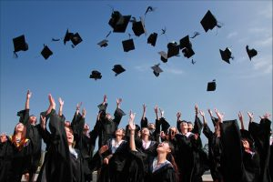 student throwing graduation caps in the air