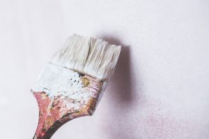 brush painting a white wall