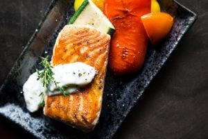grilled salmon on a black plate