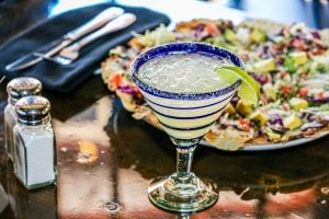 margarita and a plate of food