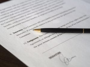 a contract and a pen placed over it