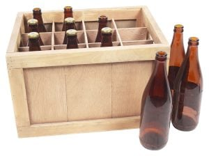 Picture of bottles in a wooden crate. Packing liquids for an interstate move requires quality packing supplies