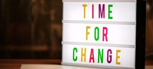 'time for change' written on a glowing background