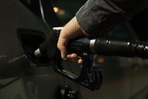 A person pouring fuel