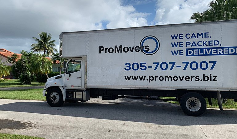 A moving truck driven by long-distance movers Miami based.