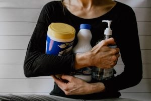 Woman holding chemicals for cleaning furniture