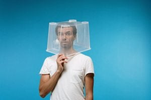 Picture of a man with a plastic box on his head