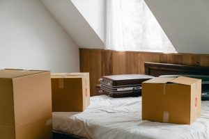moving boxes on the bed
