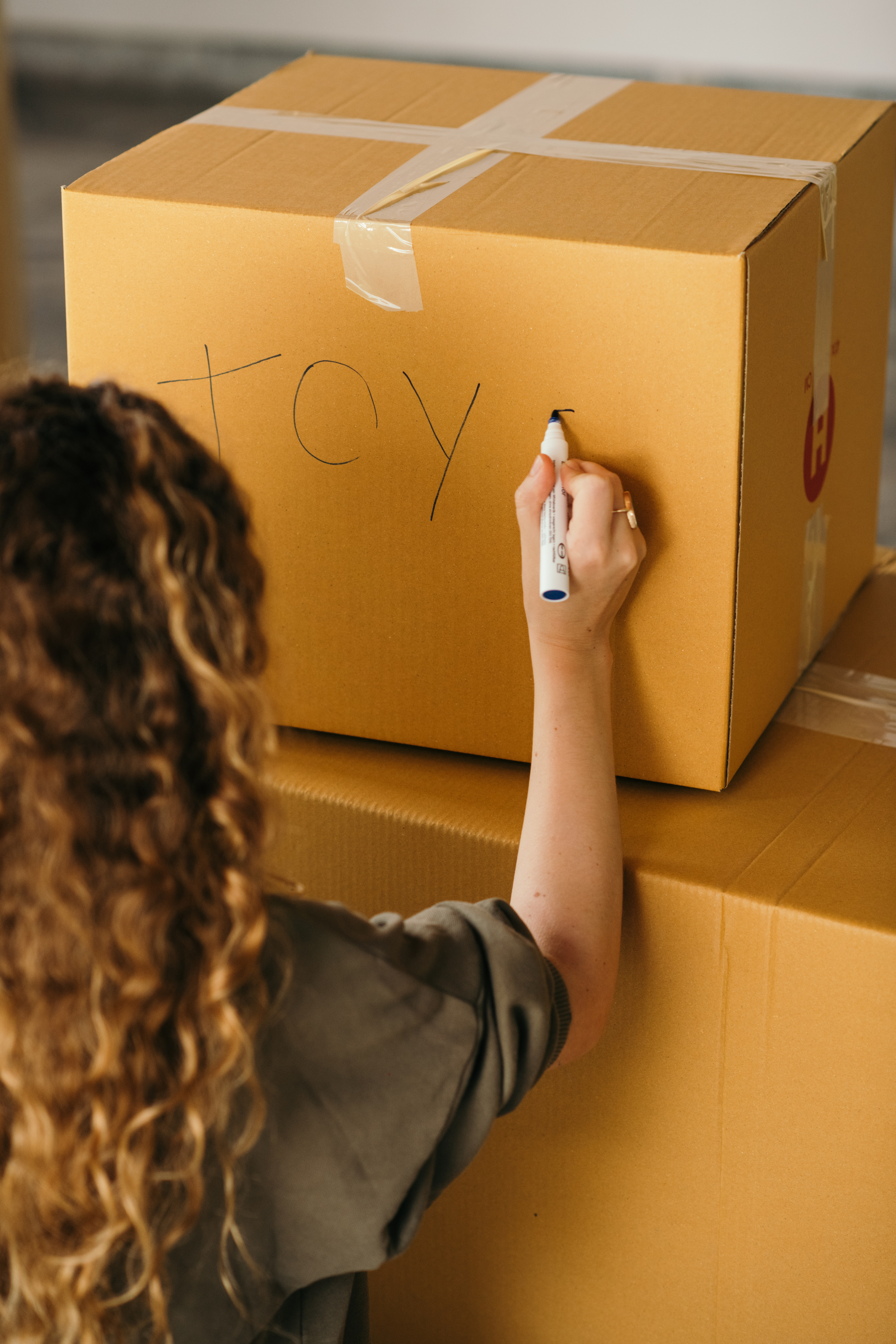 Picture of a woman labeling a box