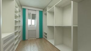 an empty white walk-in wardrobe with a window and green curtains
