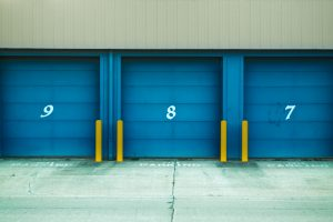 a storage unit with blue doors and numbers 9, 8, and 7.