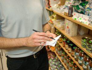 A man making an inventory list of belongings