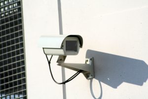 A surveillance camera on the wall of your new home can maintain security during a move from Florida