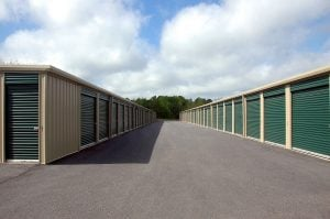 storage units with green doors, photographed during the day