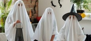 three people wearing ghost costumes