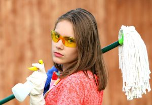 handling mold in your home - women reading to clean