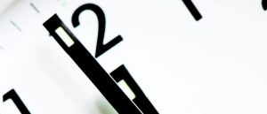 A clock showing a minute to twelve
