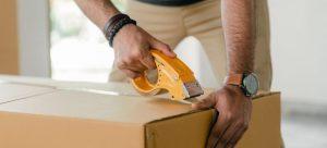 Closing a cardboard box.