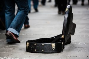 guitar case on a street