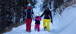 A family dressed in winter clothes